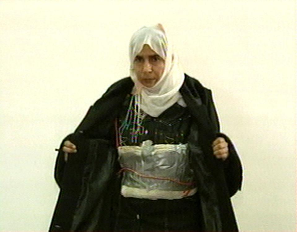 FILE  - This Nov. 13, 2005 file photo  made from television shows Iraqi Sajida al-Rishawi opens her jacket and shows an explosive belt as she...