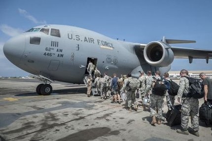 U.S. military personnel last month on their way to Liberia, an Ebola hotbed. (U.S. Air National Guard/Maj. Dale Greer/ via Reuters)