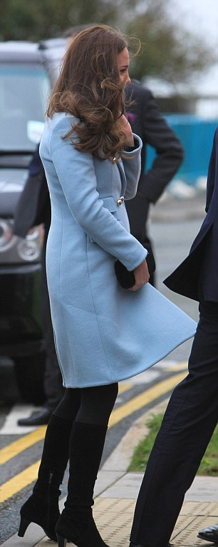 Wearing a light blue Matthew Williamson coat and heeled black boots the Duchess looked very chic
