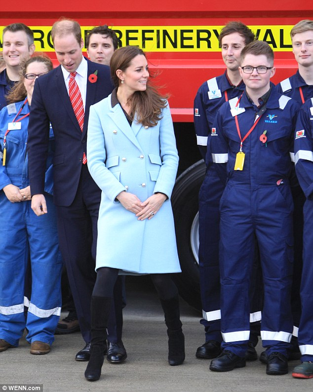 The couple laughed and joked with the refinery workers as they posed outside in the blustery conditions
