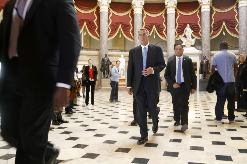 Boehner walks to the House floor for procedural votes for legislation to fund the Department of Homeland Security at the Capitol in Washington