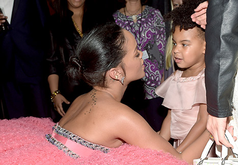 Rihanna shares a tender moment with Blue Ivy as they hug at the Grammys