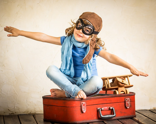 How to Survive Traveling with Your Kids This Holiday Season