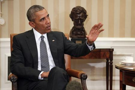 Obama says disagrees with Texas judge's immigration ruling