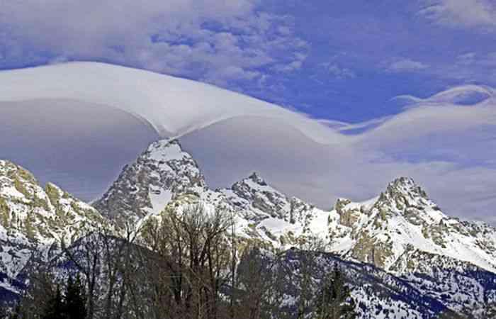 Mysterious, Wavelike Cloud Hugs Grand Teton Mountains