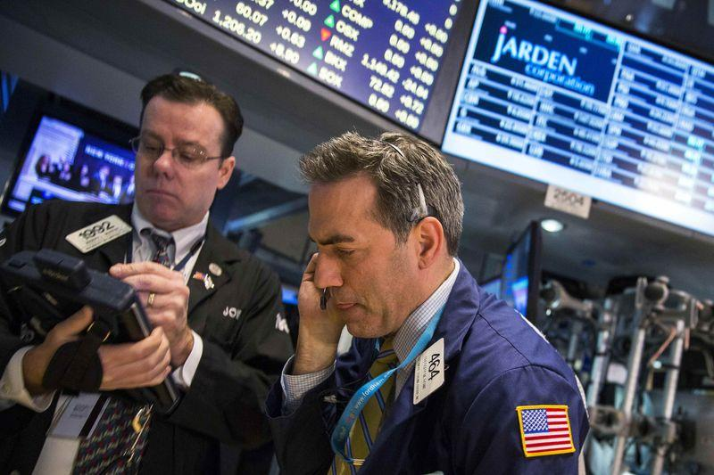Wall St. flat as mixed data offsets upbeat earnings