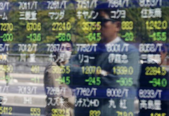 Japan slips into surprise recession, paves way for tax delay, snap poll
