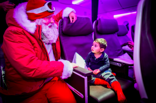Santa Flies In to Visit Passengers on Virgin Atlantic Plane