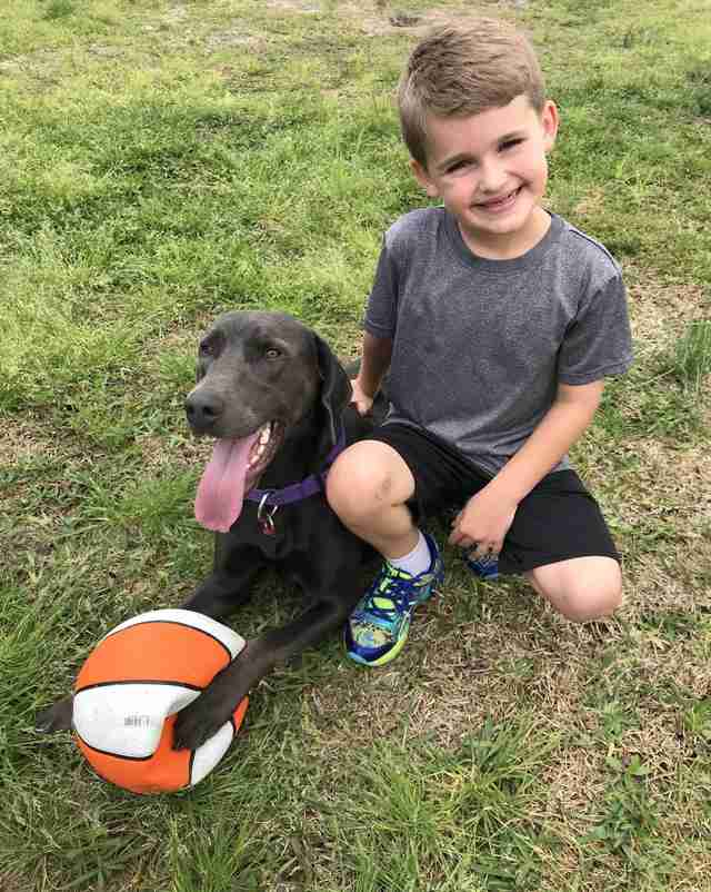 First grader Travis with his rescue dog Rosie