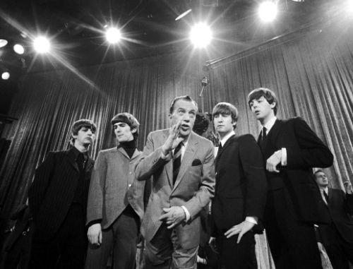 "FILE - In this Feb. 8, 1964 file photo, Ed Sullivan, center, stands with The Beatles, from left, Ringo Starr, George Harrison, John Lennon and Paul McCartney, during a rehearsal for the British group's first American appearance on ""The Ed Sullivan Show,"" in New York. While forever a Beatle in the hearts of millions - and McCartney still instinctively refers to ""we"" when telling old stories - he keeps his mind open to all moments. He tries his best to update his accounts on Facebook and Twitter, although the fine points of Spotify and other streaming services are beyond him (that's what lawyers are for). (AP Photo, File)"