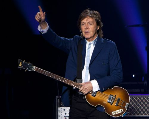 FILE - In this Oct. 15, 2014 file photo, former Beatle Sir Paul McCartney performs in concert as part of his Out There tour at Philips Arena in Atlanta. McCartney is 72, and only the wrinkles give his years away.  <div id=