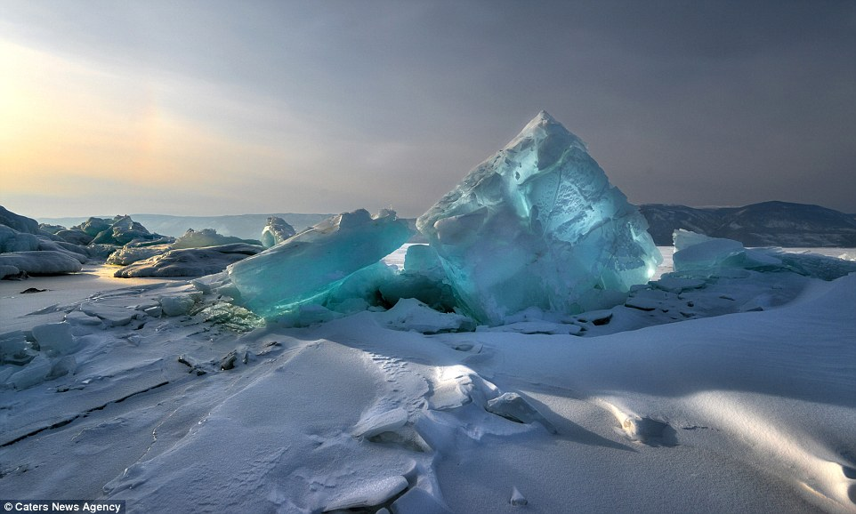 Andrey captured magical images ofhuge blocks of blue ice, known as ice hummocks, which glistened like precious stones