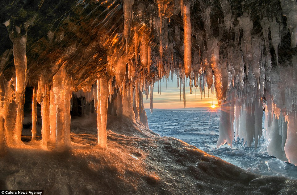 Andrey's photos provide a rare glimpse inside the frozen grotto, but he had to travel across cracked ice that could give way at any moment