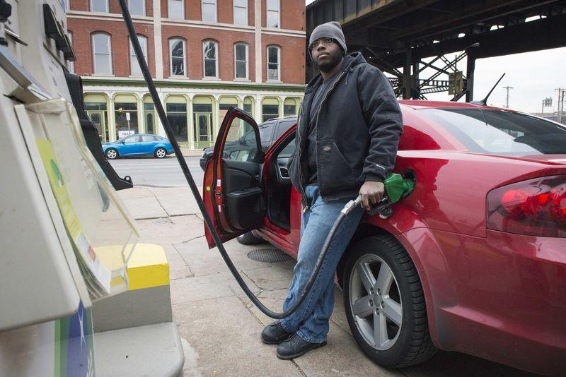 Man gets gasoline at a BP station in St. Louis, Missouri