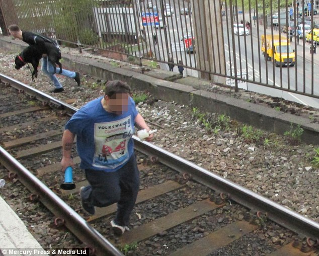 Man Jumped On To Railway Tracks To Save Dog