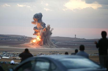 U.S., allies stage 25 air strikes on Islamic State -joint task force