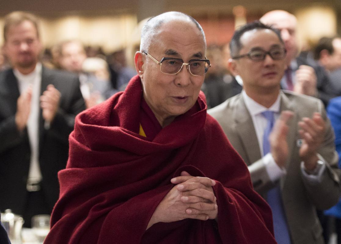 The Dalai Lama attends the National Prayer Breakfast in Washington, DC, February 5, 2015