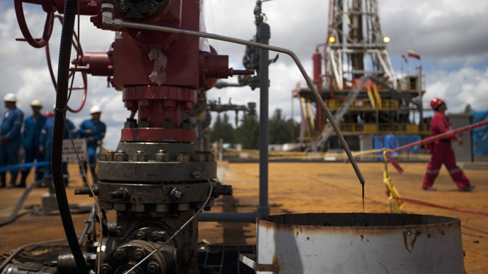 Crude oil drips from a valve at an oil well operated by Venezuela's state oil company PDVSA in Morichal. (Reuters/Carlos Garcia Rawlins)