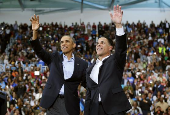 Obama makes rare campaign trail appearance, some leave early